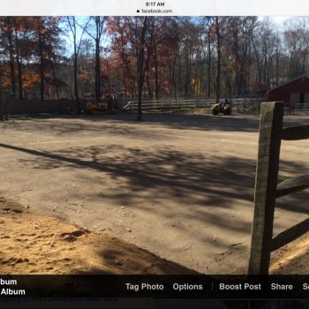 Leveled equestrian arena riding surface