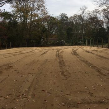Riding arena with tractor tread marks